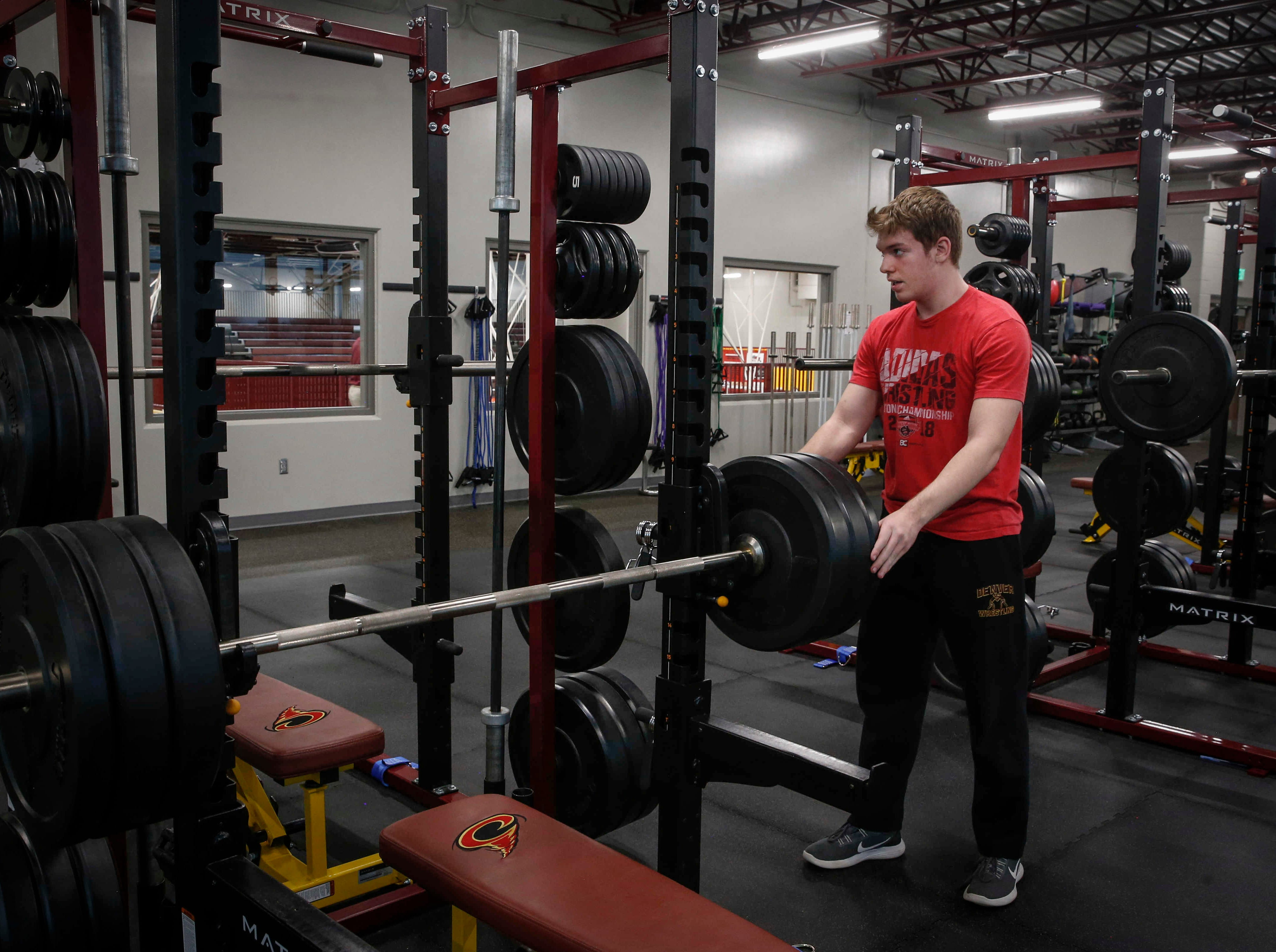 Denver sophomore Cam Krueger works out in the weight room at Denver High School in Denver on Tuesday, Jan. 15, 2019. Krueger, who was born legally blind, says weight lifting is something he is passionate about.