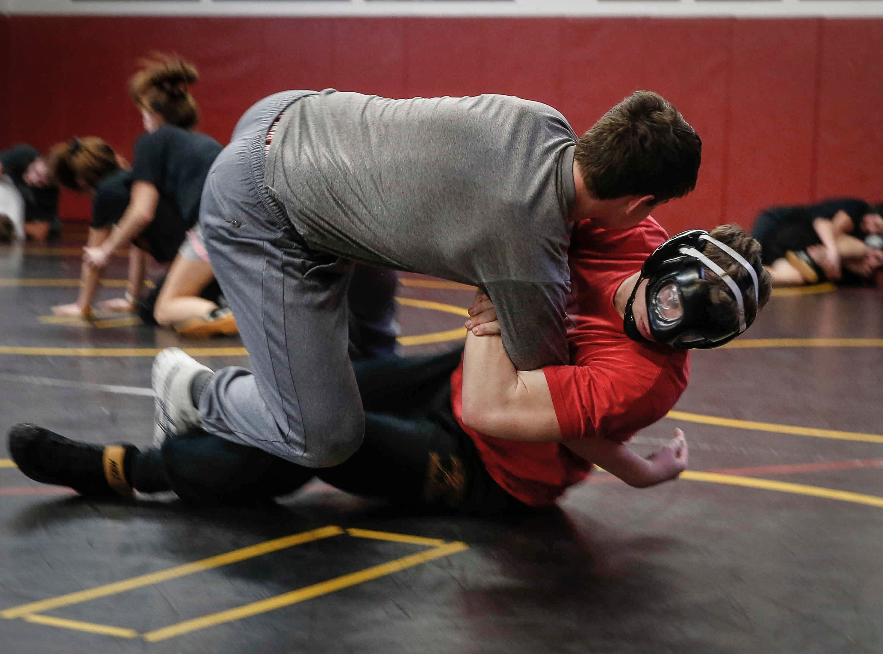 Denver sophomore Cam Krueger runs drills during wrestling practice at Denver High School in Denver on Tuesday, Jan. 15, 2019. Krueger hasn't let the fact that he is legally blind step in the way of his passion for wrestling.