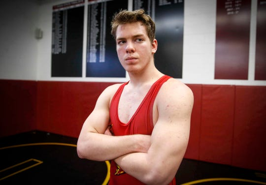 Cam Krueger, a sophomore wrestler at Denver High School, has had to battle adversity and setbacks during his entire wrestling career. Born legally blind, Krueger has worked hard to develop a style that helps him on the mat. Using his upper body strength achieved by hours every week in the weight room, Krueger has become a throw artist, and many of the matches he's won haven't lasted past the first period.