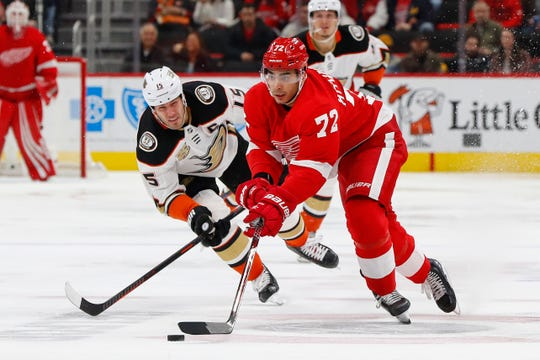 Detroit Red Wings center Andreas Athanasiou receives a pass in front of Anaheim Ducks center Ryan Getzlaf in the second period Tuesday, Jan. 15, 2019, in Detroit.