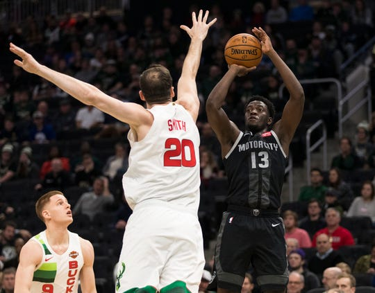 Detroit Pistons guard Khyri Thomas shoots against Milwaukee Bucks forward Jason Smith (during the fourth quarter at Wisconsin Entertainment and Sports Center, Jan. 1, 2019 in Milwaukee.