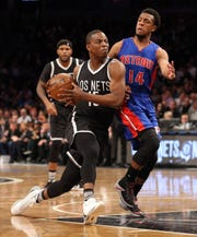 Nets guard Isaiah Whitehead drives against Pistons guard Ish Smith at Barclays Center, March 21, 2017 in Brooklyn.