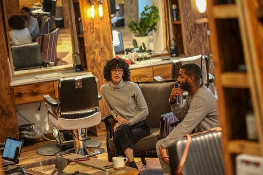 """Gabrielle Jackson, 31, and her husband and business partner Sebastian Jackson, 32, both of Detroit, talk about how the concept of their """"Shop Talk"""" has been there since the conception of the Social Club Grooming Company on the Wayne State University campus in Detroit on Friday, Jan. 11, 2019."""