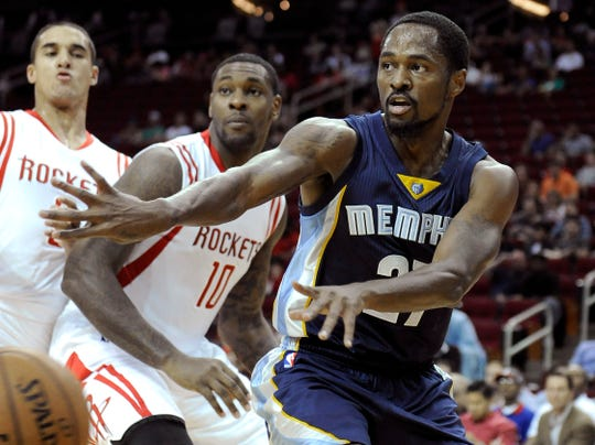 Memphis Grizzlies' Kalin Lucas passes against the Houston Rockets, Oct. 9, 2014, in Houston.