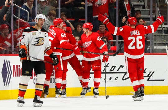 Gustav Nyquist, center, celebrates his goal as Ducks center Ryan Getzlaf skates to the bench in the third period Tuesday at LCA.