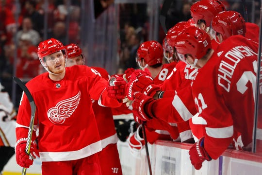 Will Gustav Nyquist, seen here celebrating his goal against the Anaheim Ducks on Jan. 15, 2019, in Detroit, soon be bumping fists with new teammates?