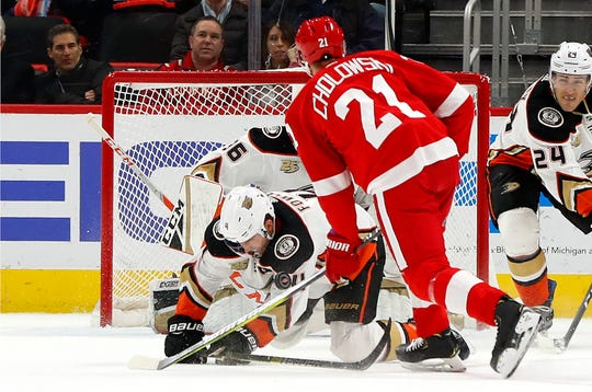 Anaheim Ducks defenseman Cam Fowler blocks a shot by Detroit Red Wings defenseman Dennis Cholowski in the first period Tuesday, Jan. 15, 2019, in Detroit.
