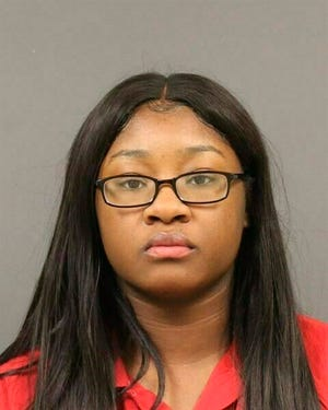 This photo provided by Berrien County Sheriff's Office on Jan. 14, 2019, shows Nemia Hassel. Hassel is charged with murder in Berrien County, Michigan, in the fatal shooting of her husband and fellow Army soldier, Sgt. Tyrone Hassel III, who was killed on Dec. 31, 2018. Prosecutors believe she arranged his death so she could continue an affair with another soldier at Fort Stewart, an Army base in Georgia.