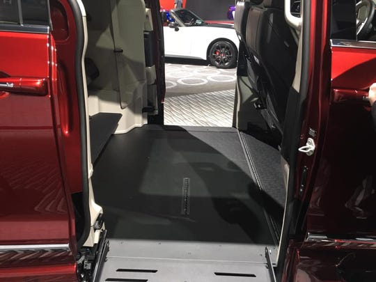 The wheelchair ramp and side door for backseat passengers are shown in a 2019 Chrysler Pacifica converted for wheelchair accessibility on display at the 2019 North American International Auto Show at Cobo Center in Detroit, Michigan, on Jan. 16, 2019.