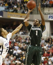 Kalin Lucas scores against Penn State's Tim Frazier during the Big Ten tournament March 12, 2011.