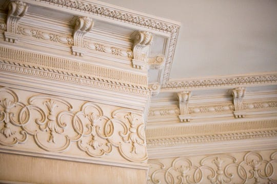 Atop walls at the ceiling is a stack of crown moldings measuring about 15 inches deep that includes thick dentil molding, so named because it looks like teeth.
