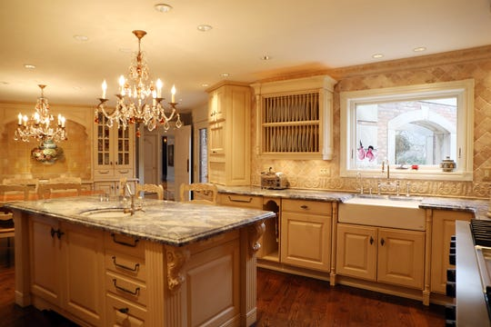 The eat-in kitchen has a huge cooking alcove and lavish butler's pantry .