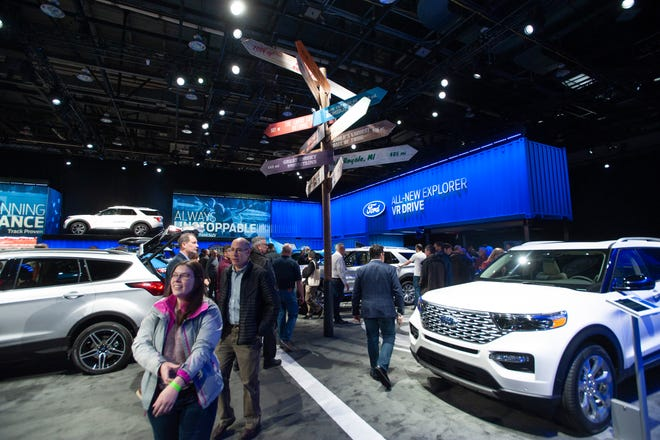 People check out the vehicles and other attractions in the Ford Motor Company exhibit space at the North American International Auto Show at Cobo Center in Detroit on Wednesday, January 16, 2019.