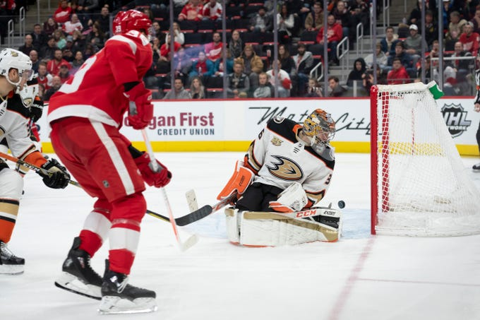 Detroit right wing Anthony Mantha slips the puck past Anaheim goaltender John Gibson for a goal in the third period of their game at Little Caesars Arena, in Detroit, January 15, 2019. The Red Wings defeated the Ducks 3-1.