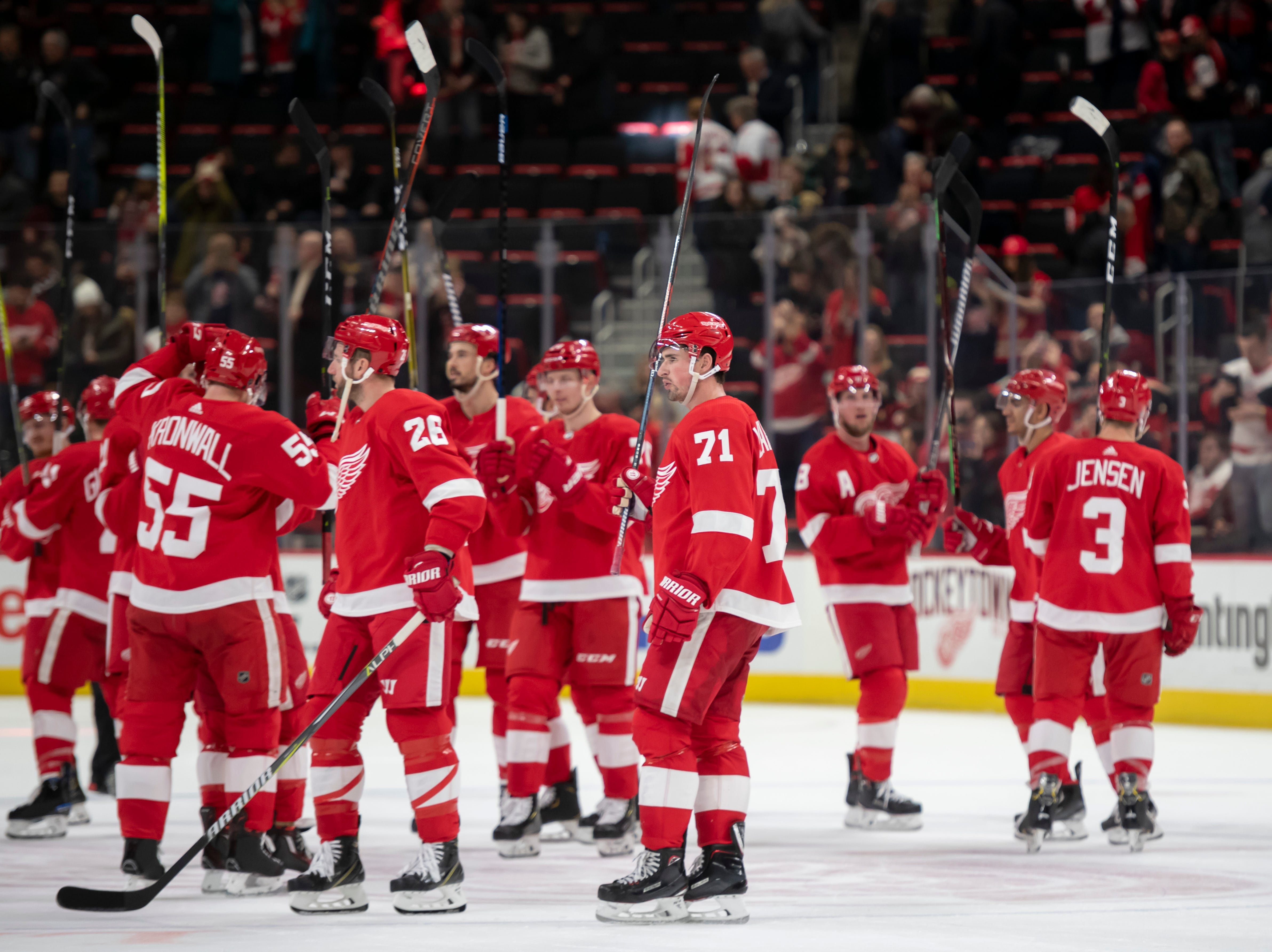 The Red Wings celebrate their win after the game.