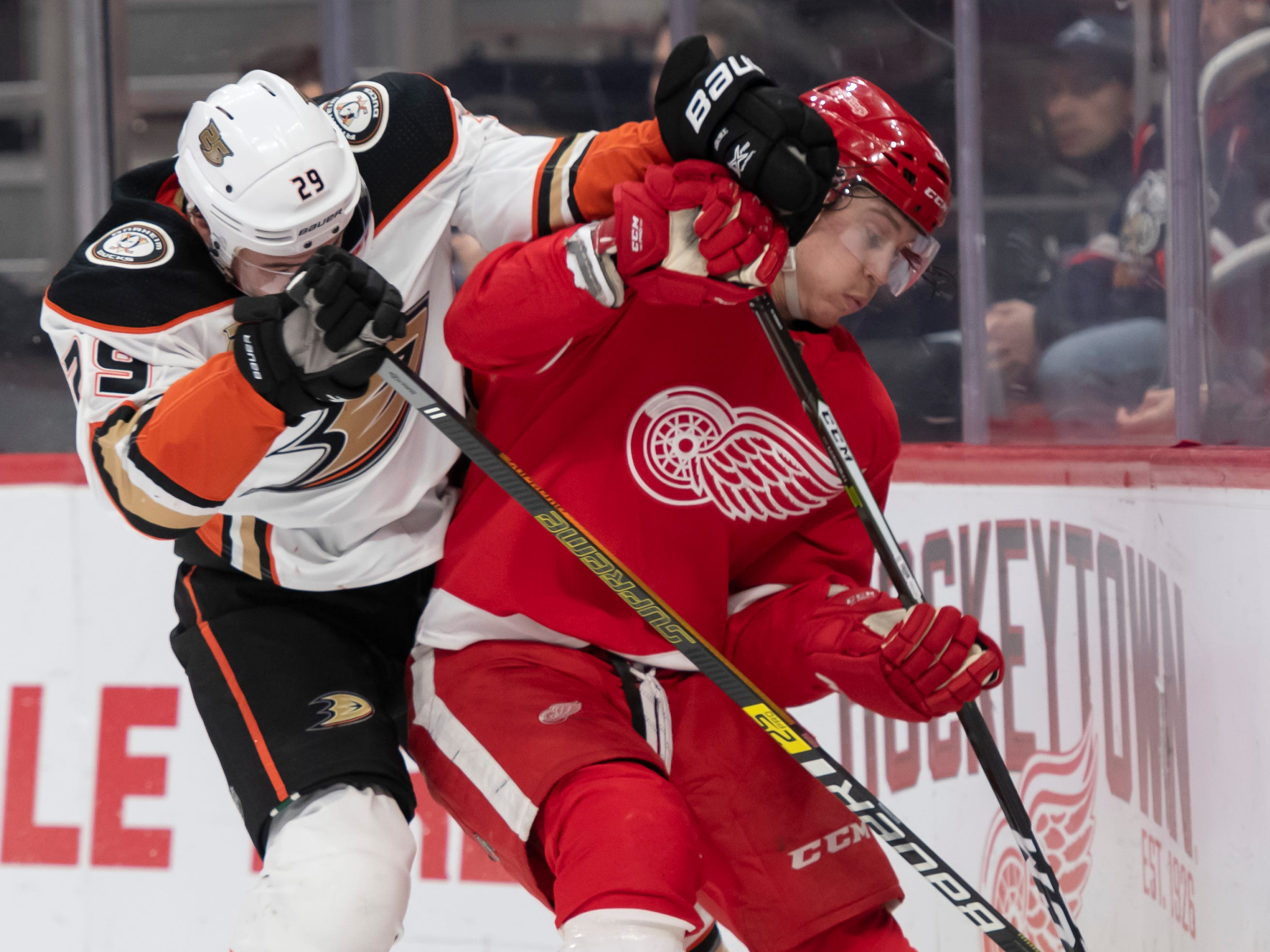 Detroit left wing Tyler Bertuzzi and Anaheim center Devin Shore battle for the puck in the second period.