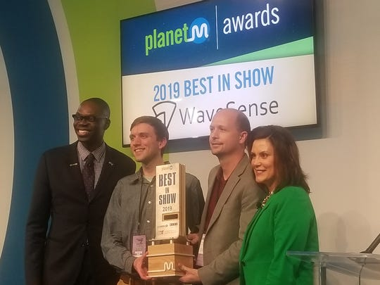 Gov. Gretchen Whitner and Lt. Gov. Garlin Gilchrist, left, award WaveSense Chief Technology Officer Byron Stanley, second from right, the best in show award at PlanetM's second annual awards during the North American International Auto Show.