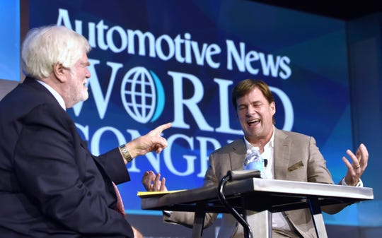Crain Communications, Inc. Chairman and Automotive News Editor-in-Chief Keith Crain, left, interviews Jim Farley, president global markets, at Ford Motor Company, on stage during the NAIAS Automotive News World Congress in the Renaissance Ballroom on Tuesday.