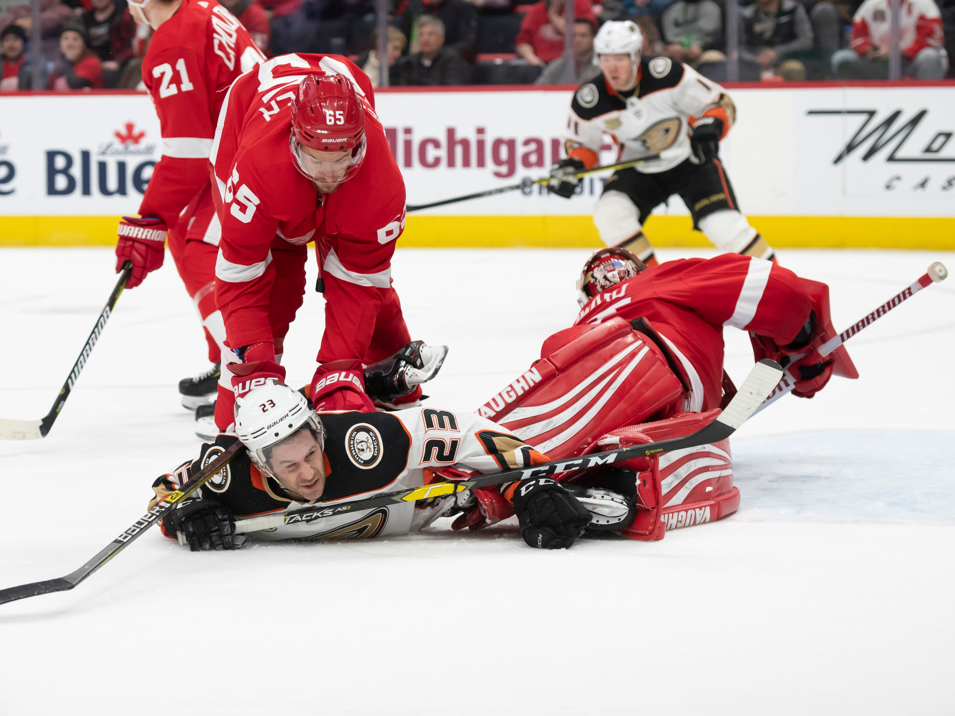 Anaheim center Brian Gibbons is pushed to the ice by Detroit defenseman Danny DeKeyser in the second period.