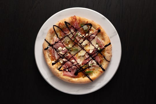 "The ""Juliet"" pizza at Mootz Pizzeria + Bar is topped with prosciutto, fig jam, gorgonzola, mozzarella and balsamic glaze."