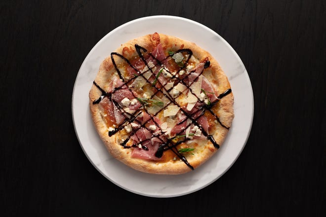 """The """"Juliet"""" pizza at Mootz Pizzeria + Bar is topped with prosciutto, fig jam, gorgonzola, mozzarella and balsamic glaze."""