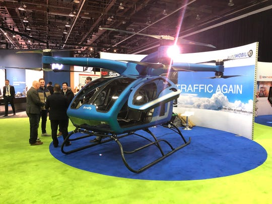The Surefly Octocopter on the floor of the Detroit auto show
