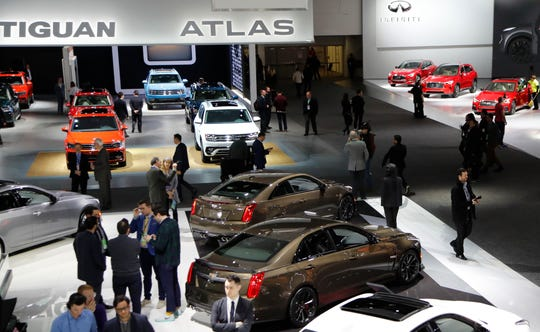 Overview of the Cadillac, Volkswagen and Infiniti display on Tuesday at the North American International Auto Show at Cobo Center.
