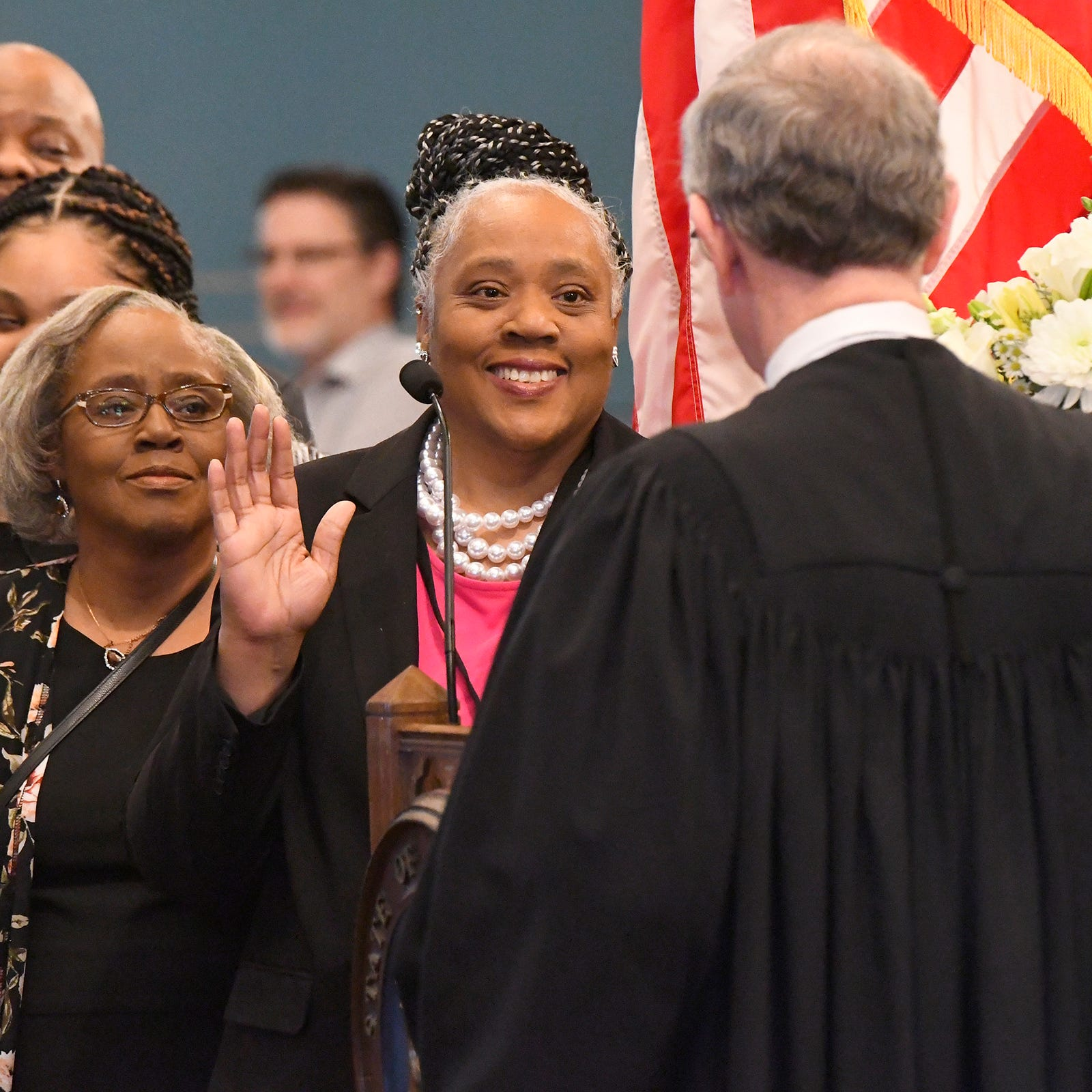 New State Sen. Betty Jean Alexander, of Detroit's 5th district, is sworn in by Chief Justice Stephen Markman during opening ceremonies for the 100th Legislature in Lansing on January 9.