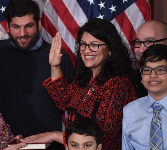 U.S. Rep. Rashida Tlaib, D-Detroit, wearing a traditional Palestinian robe, takes the oath of office  in the U.S. Capitol on Jan. 3.