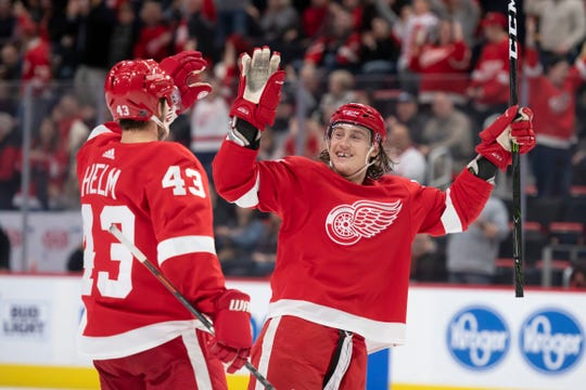 Red Wings center Darren Helm, left, and left wing Tyler Bertuzzi celebrate Helm's third-period goal in Tuesday's 3-1 win over the Ducks.