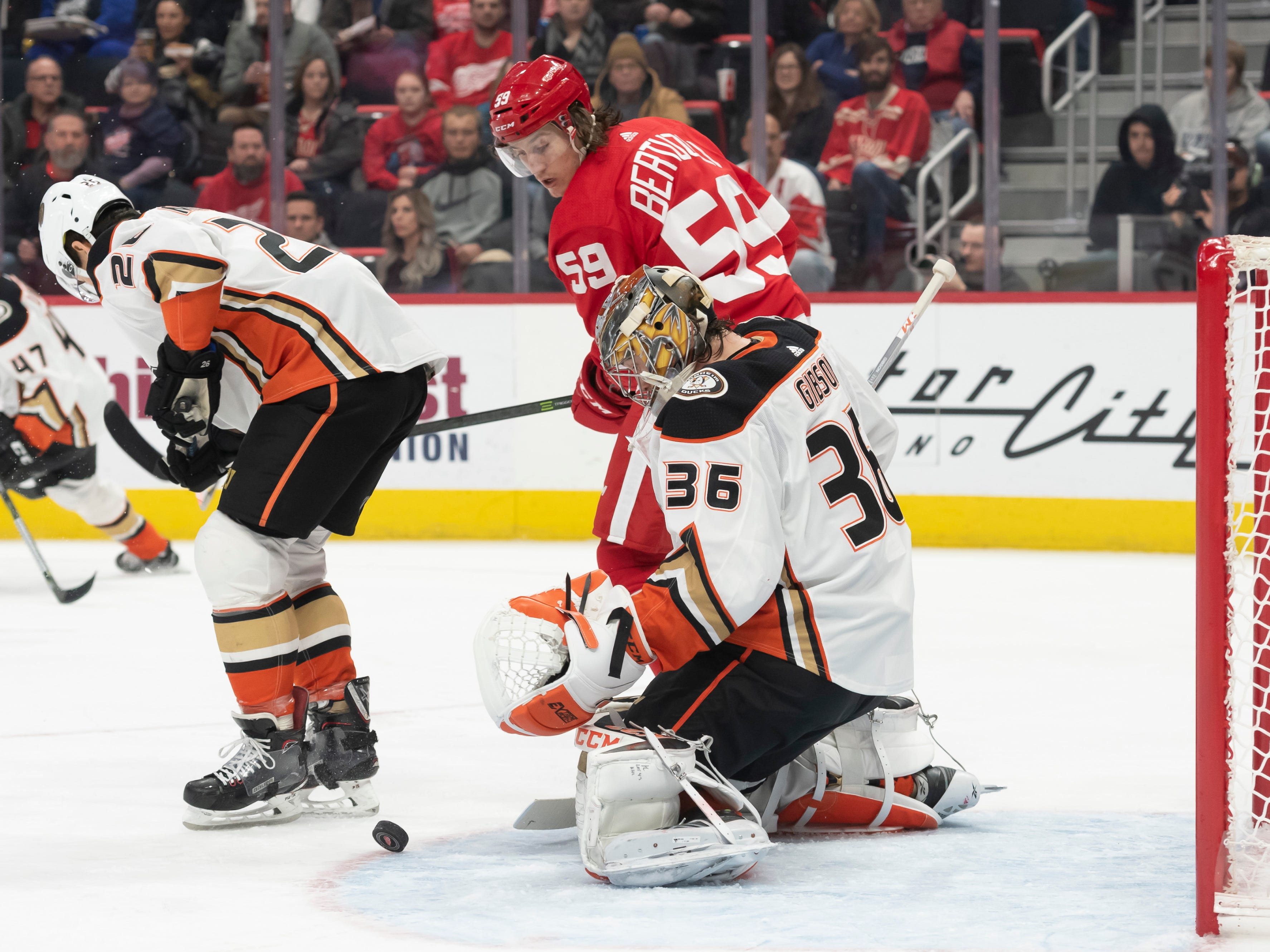 Detroit left wing Tyler Bertuzzi tries to get the puck past Anaheim goaltender John Gibson in the first period.