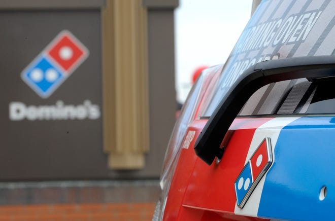 The Domino's logo is below the rear windshield wiper.