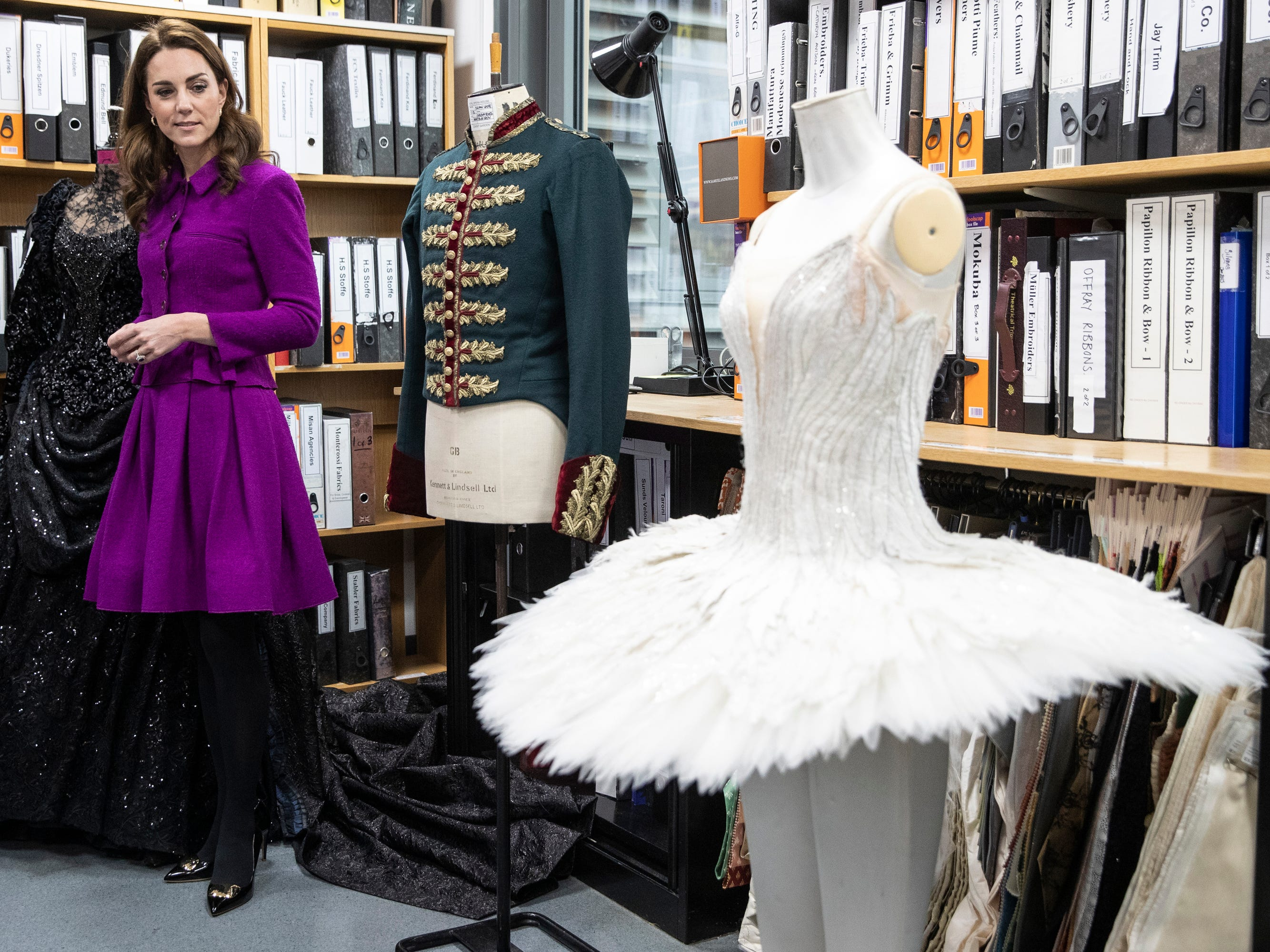 Britain's Kate, Duchess of Cambridge, views costumes in the Pattern Room during a visit to the Costume Department and to meet with Principal Dancers at The Royal Opera in London, Wednesday, Jan. 16, 2019.