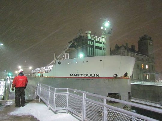 The 664-foot freighter Manitoulin is the last ship through Michigan's Soo Locks before they closed for winter. The ship approached the locks  around 9 p.m. Tuesday, passing through before the locks' midnight Jan. 15 deadline.