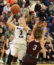 Watkins Glen's Hannah Morse goes up f or a shot as Odessa-Montour's Kennedey Heichel defends in girls basketball Jan. 15, 2019 at Watkins Glen High School.