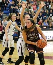 Olivia Grover of Odessa-Montour looks for room on the offensive end as Adrienna Solomon of Watkins Glen defends Jan. 15, 2019 at Watkins Glen High School.