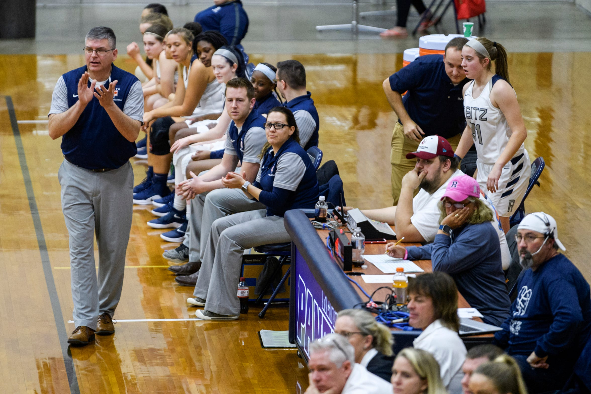 Reitz Head Coach Gary Loveless, left, paces the bench as he watches his team take on the Castle Knights in a conference game at F.J. Reitz High School in Evansville, Ind., Thursday, Jan. 3, 2019. The Panthers were defeated by the Knights, 51-17.