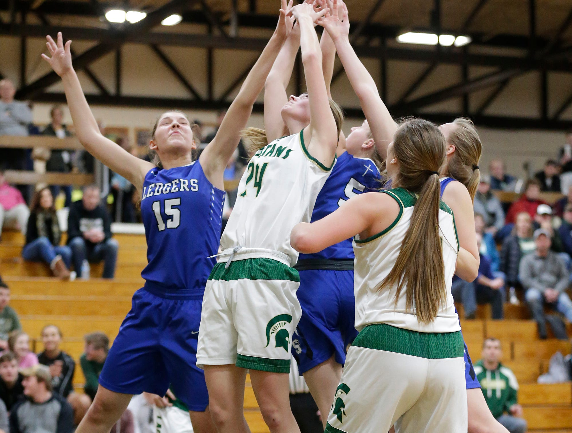 Laconia High School and St. Mary's Springs Academy girls basketball players reach for a rebound Tuesday, January 15, 2019 during their game in Rosendale. Laconia won the game 57-45. Doug Raflik/USA TODAY NETWORK-Wisconsin