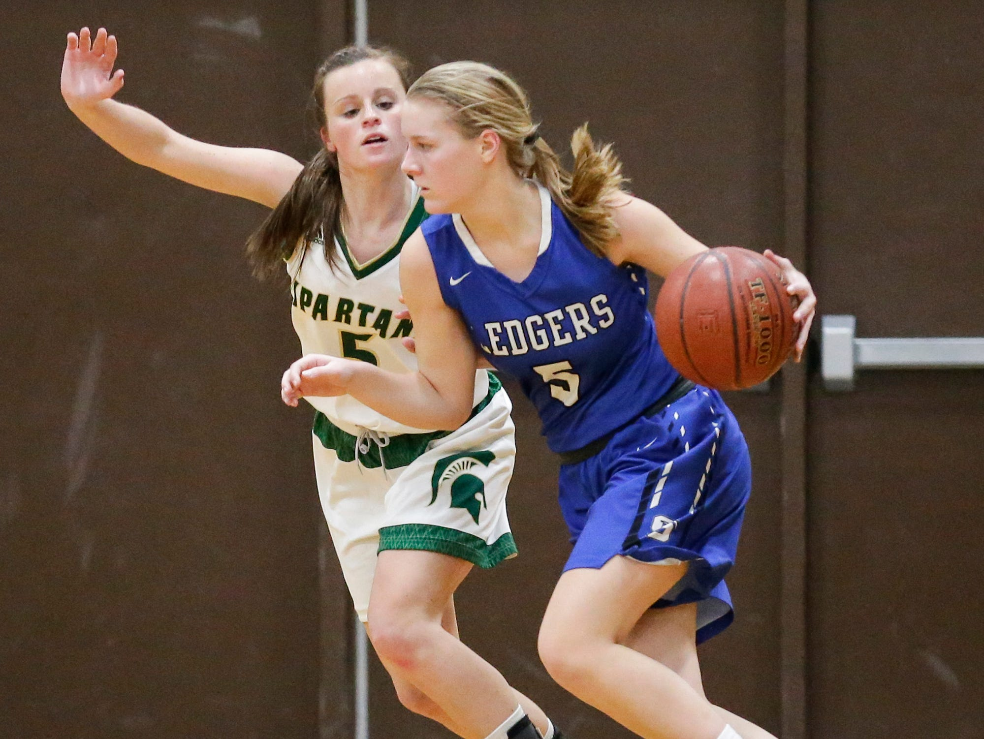 St. Mary's Springs Academy girls basketball's Gracie Rieder makes her way past Laconia High School's Jen Beattie Tuesday, January 15, 2019 during their game in Rosendale. Laconia won the game 57-45. Doug Raflik/USA TODAY NETWORK-Wisconsin