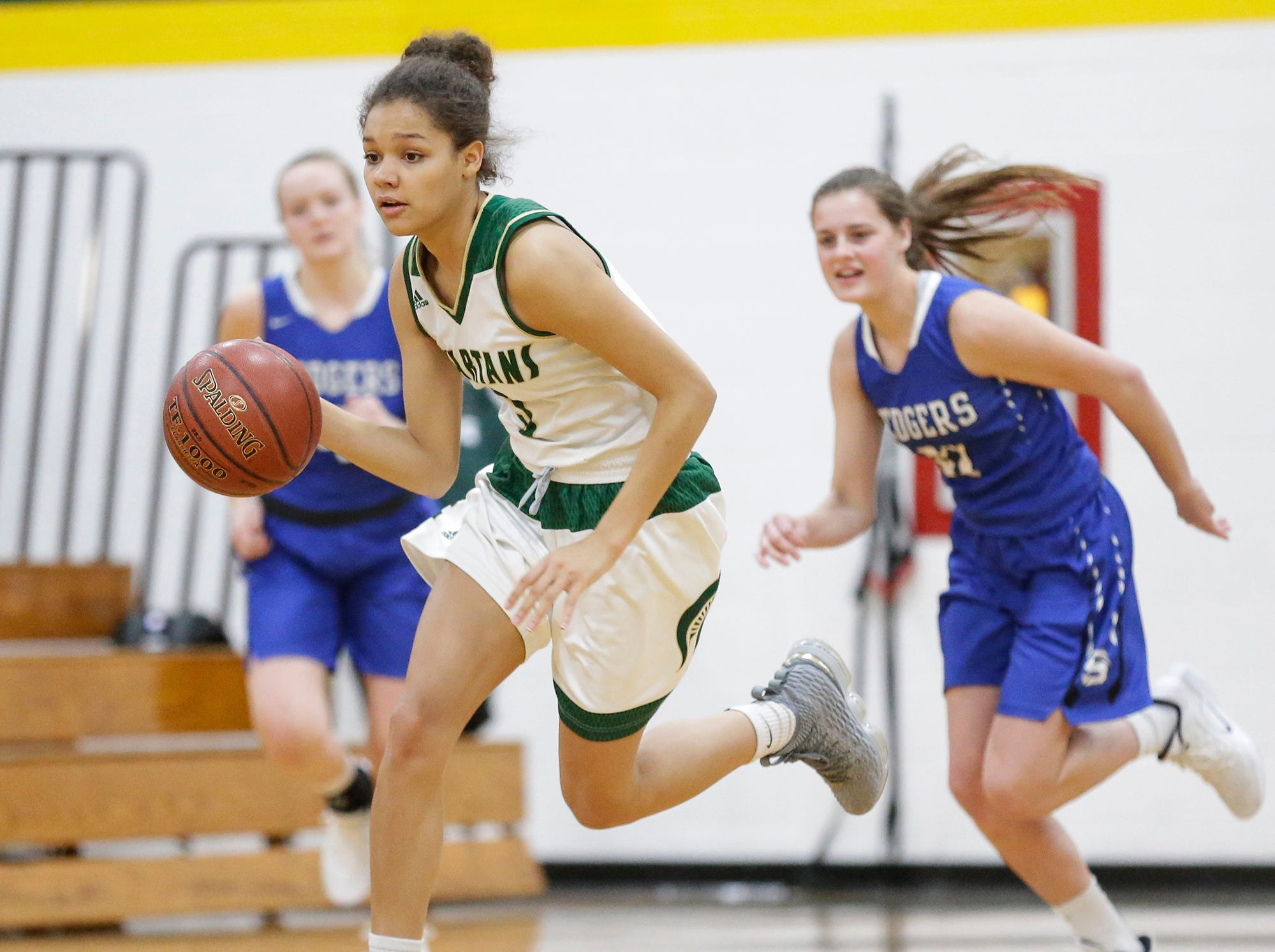 Laconia High School girls basketball's Kiarra Otto runs down court with the ball against St. Mary's Springs Academy Tuesday, January 15, 2019 during their game in Rosendale. Laconia won the game 57-45. Doug Raflik/USA TODAY NETWORK-Wisconsin