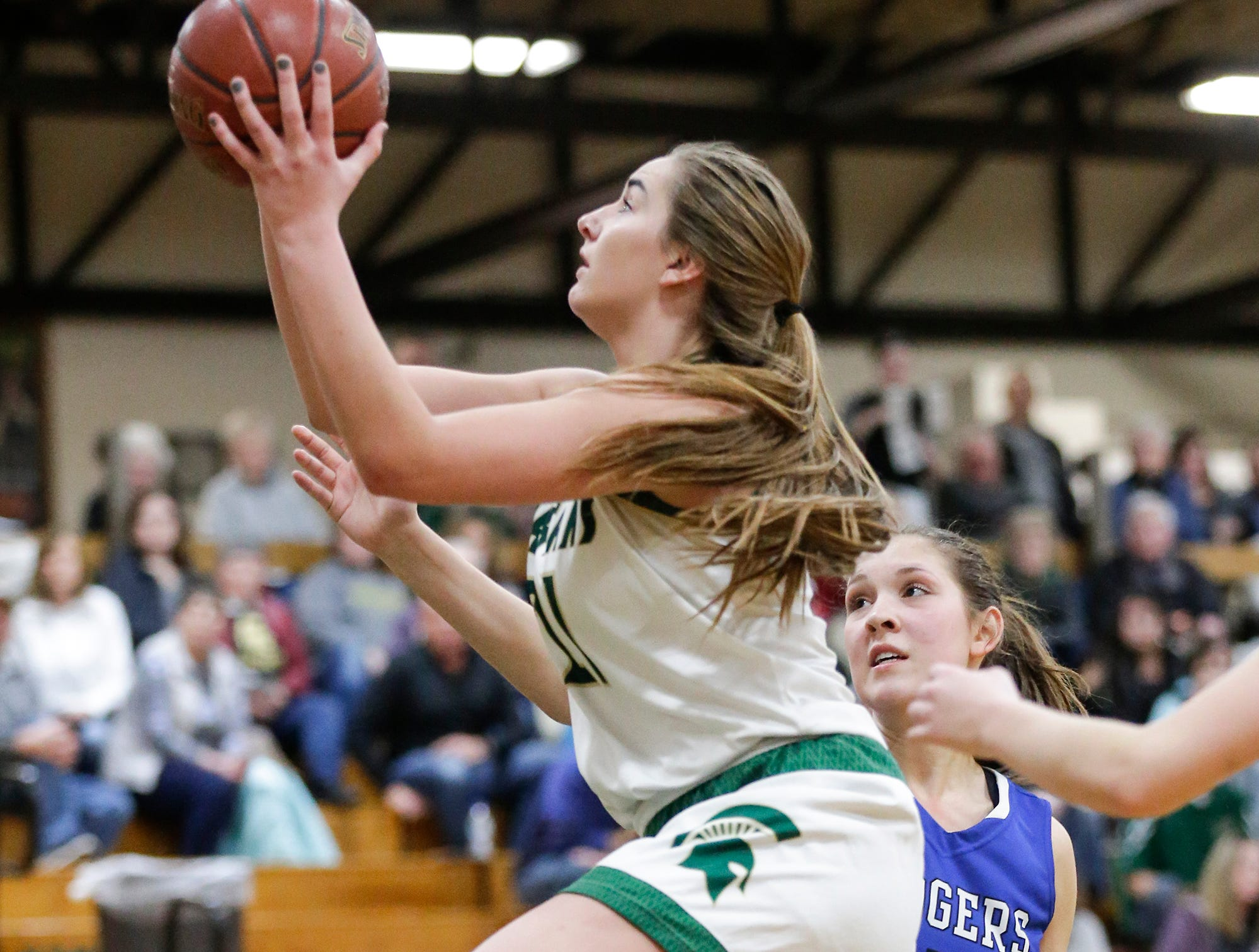 Laconia High School girls basketball's Alissa Dins goes up for a basket against St. Mary's Springs Academy Tuesday, January 15, 2019 during their game in Rosendale. Laconia won the game 57-45. Doug Raflik/USA TODAY NETWORK-Wisconsin