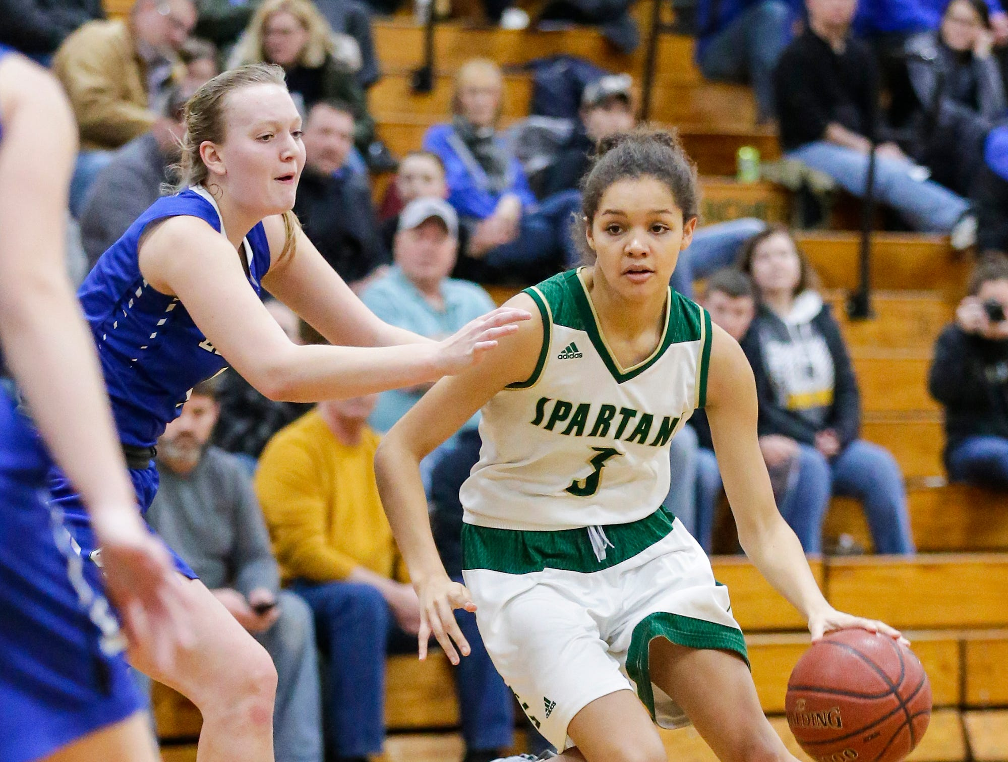 Laconia High School girls basketball's Kiarra Otto makes her way around St. Mary's Springs Academy's Brianna Fruend Tuesday, January 15, 2019 during their game in Rosendale. Laconia won the game 57-45. Doug Raflik/USA TODAY NETWORK-Wisconsin