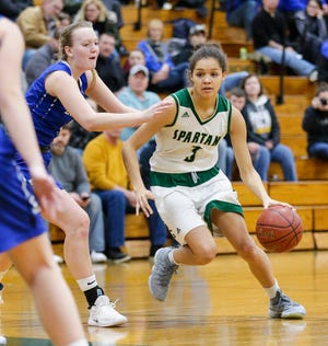Laconia's Kiarra Otto drives against Fond du Lac Springs' Brianna Freund during a Jan. 15 game in Rosendale. Laconia is undefeated and ranked No. 1 in the latest G10 power rankings.