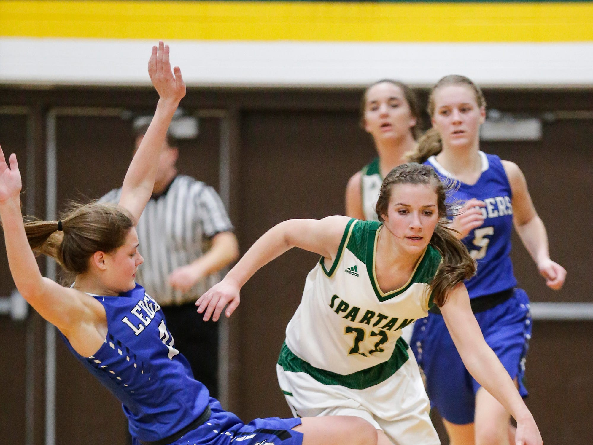St. Mary's Springs Academy girls basketball's Jennifer Chatterton gets called for a foul while defending against Laconia High School's Haley Rens Tuesday, January 15, 2019 during their game in Rosendale. Laconia won the game 57-45. Doug Raflik/USA TODAY NETWORK-Wisconsin