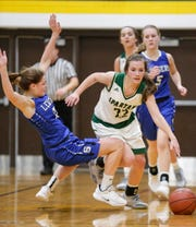 St. Mary's Springs' Jennifer Chatterton gets called for a foul while defending against Laconia's Haley Rens on Jan. 15 in Rosendale.