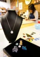 Examples of cremains jewelry Tuesday, January 15, 2019 in Trista Holz's Fond du Lac art studio. Doug Raflik/USA TODAY NETWORK-Wisconsin