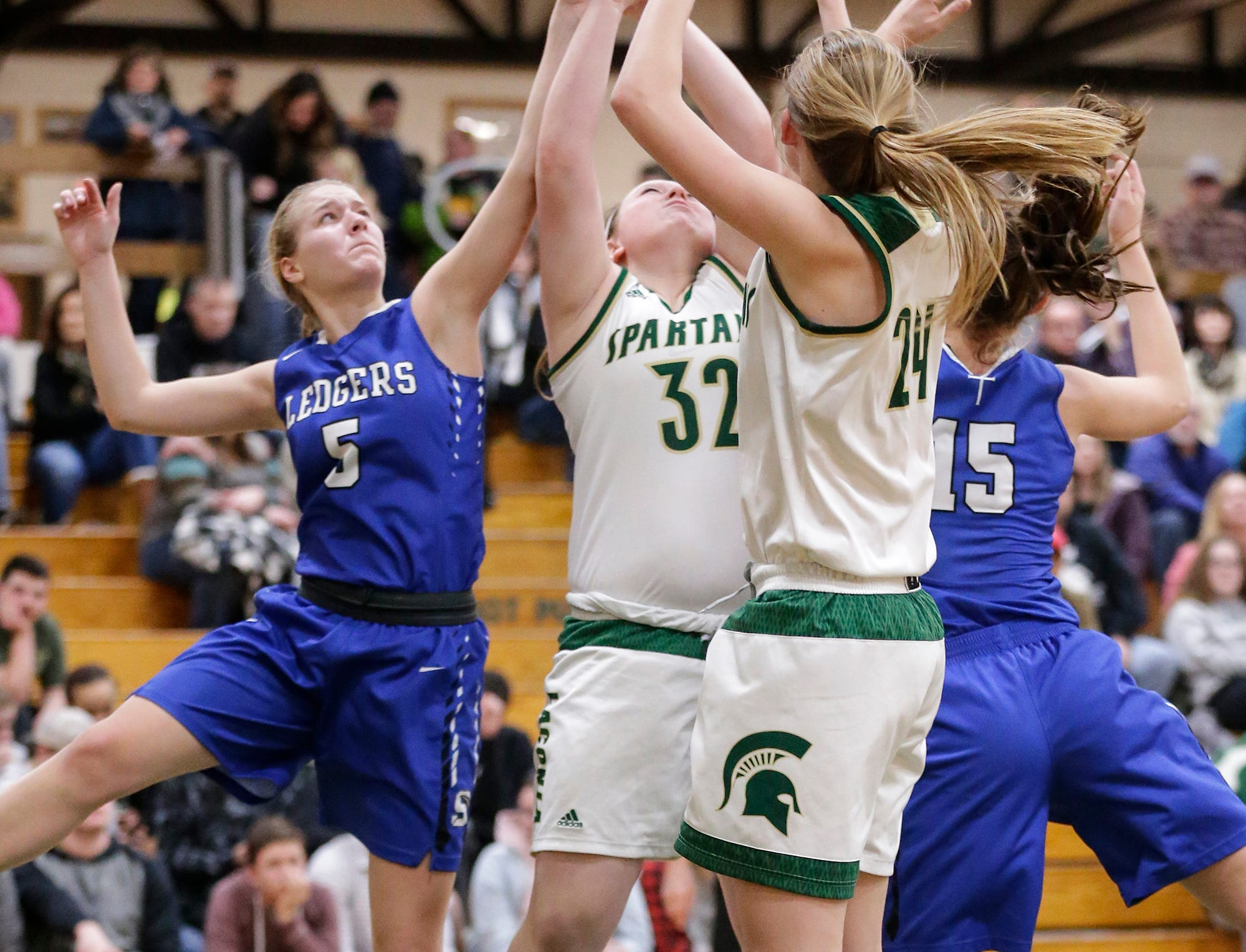 Laconia High School girls basketball's Abby Luczak (32) and Maci Grade (24) battle for a rebound with St. Mary's Springs Academy's Gracie Rieder (5) and Maddie Gehring (15) Tuesday, January 15, 2019 during their game in Rosendale. Laconia won the game 57-45. Doug Raflik/USA TODAY NETWORK-Wisconsin