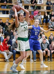 Laconia's Alissa Dins looks to pass against St. Mary's Springs during a Jan. 15 game. Coach Chris Morgan said she's the best passer he has seen.