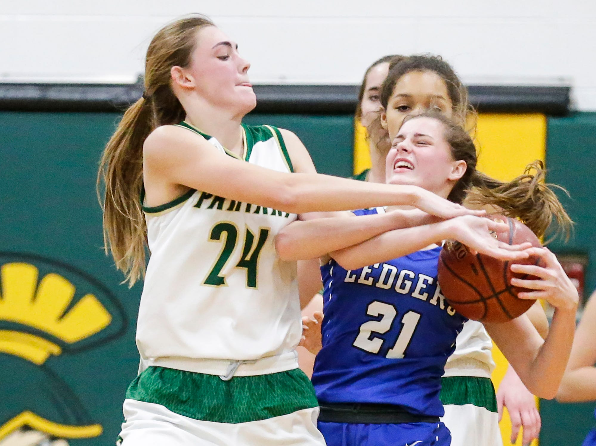 Laconia High School girls basketball's Maci Grade battles for the ball with St. Mary's Springs Academy's Jennifer Chatterton Tuesday, January 15, 2019 during their game in Rosendale. Laconia won the game 57-45. Doug Raflik/USA TODAY NETWORK-Wisconsin