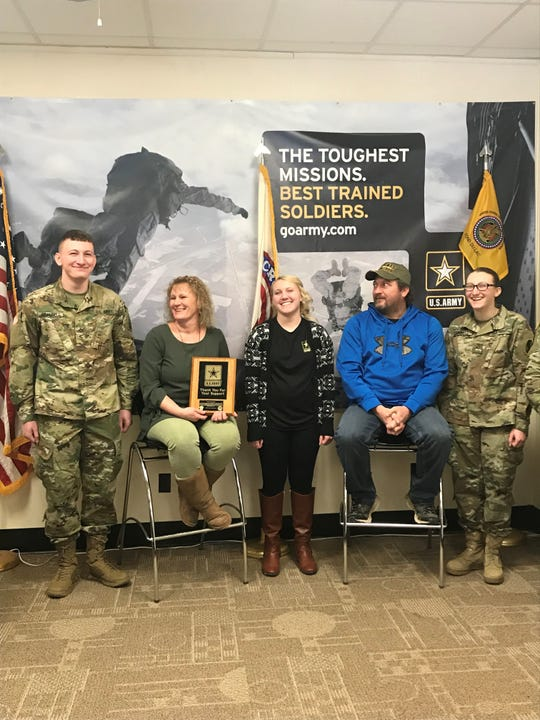 The Scannell family of Campbellsport were given a plaque as recognition for their support of their children, who all enlisted in the Army. From left, Bret, Audra, Brianna, Brian and Ashlynn Scannell.